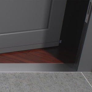 Threshold-free house entrance with stainless steel trims